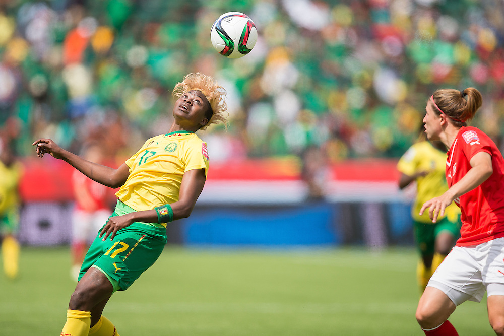 Cameroon's Gaelle Enganamouit heads the ball during the first half of their FIFA Women's World Cup group C match against Switzerland at Commonwealth Stadium in Edmonton, Canada on June 16, 2015.   AFP PHOTO/GEOFF ROBINS