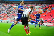 Grimsby Town defender Richard Tait clears under pressure from FC Halifax Town striker Richard Peniket during the FA Trophy match between Grimsby Town FC and Halifax Town at Wembley Stadium, London, England on 22 May 2016. Photo by Mike Sheridan.
