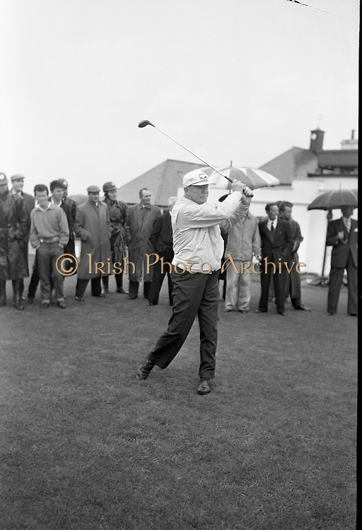 General Dwight D. Eisenhower plays golf in the rain with Joe Carr, the Irish Walker Cup Player, Mr. M. McCluskey, the United States Ambassador to Ireland, and Mr. Freeman Godsen, a member of the Generals Party, at Portmarnock Golf Club..Eisenhower drives off from the first tee..23.08.1962.<br />