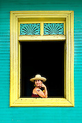 Portrait of a Nicaraguan woman in the window of her Spanish Colonial home in San Juan del Sur, Nicaragua.