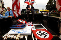 COEUR D ALENE, ID - JULY 17:  Rev. Richard Butler, leader of the Aryan Nations, sits in the back of a truck at the beginning of the World Congress Parade held in Coeur d'Alene, Idaho, on Saturday, July 17, 2004. About 40 supporters and members marched in downtown Coeur d'Alene for the Aryan World Congress.