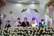 Uzbekistan, Samarqand. Wedding party. Serious looks for good luck!