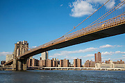 Brooklyn Bridge across the East River with view of red brick apartment blocks of The Governor Alfred E. Smith Houses, a public housing development, as seen from Main Street Park, Dumbo, Brooklyn, New York City, United States of America.  (photo by Andrew Aitchison / In pictures via Getty Images)