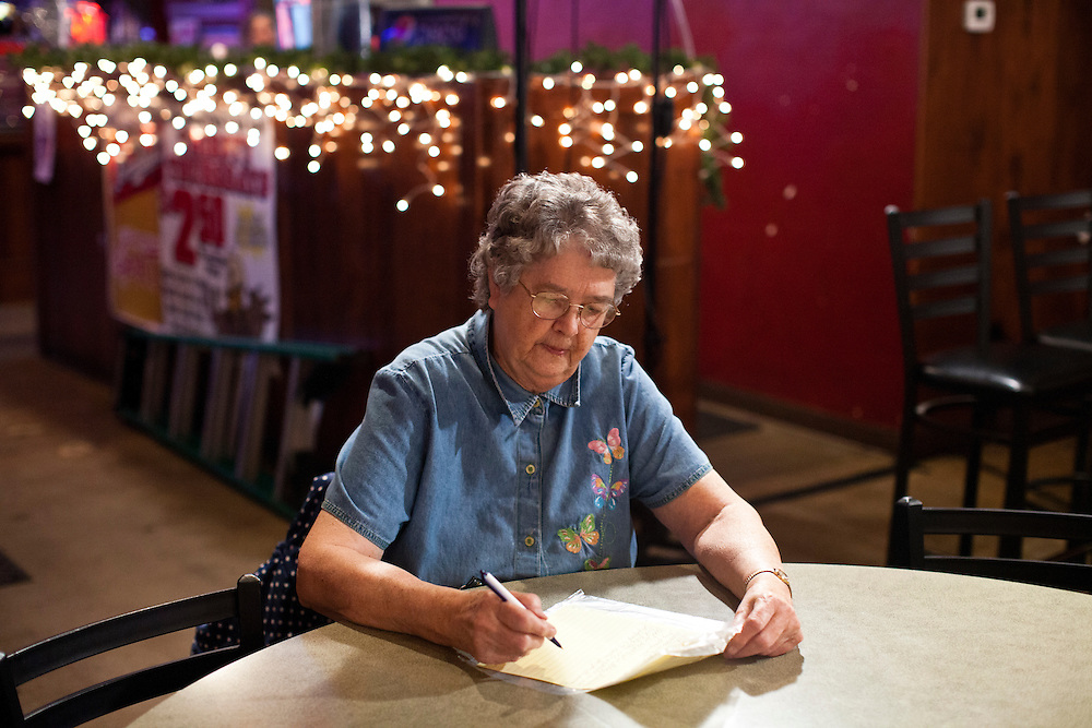 Florine Christensen, of Parksville, Iowa, writes a letter to Republican presidential candidate Rick Perry before his campaign stop at the Fainting Goat on Friday, December 30, 2011 in Waverly, IA.