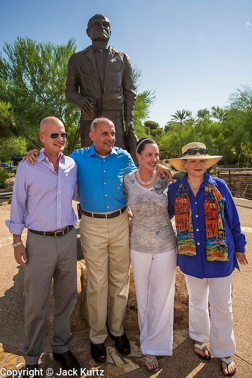 29 AUGUST 2012 - PARADISE VALLEY, AZ:   Dr. RICHARD CARMONA, Democratic candidate for US Senate from Arizona, (center, blue shirt) with TYLER ROSS GOLDWATER, left, CC GOLDWATER and JOANNE GOLDWATER in front of a statue of Barry Goldwater after a press conference in Barry Goldwater Memorial Park in Paradise Valley, AZ, Wednesday. Carmona won the endorsements of Joanne Goldwater, daughter of Barry Goldwater, the late legendary Republican Senator from Arizona. He was also endorsed by CC Goldwater, her daughter, and Tyler Ross Goldwater, CC Goldwater's son. Barry Goldwater was from Paradise Valley.   PHOTO BY JACK KURTZ