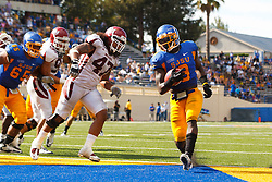 September 24, 2011; San Jose, CA, USA;  San Jose State Spartans running back Brandon Rutley (9) scores a touchdown against the New Mexico State Aggies during the fourth quarter at Spartan Stadium. San Jose State defeated New Mexico State 34-24.