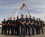 Firemen from the B shift at fire stations 89 and 98 pose under a flag they hoisted up between the ladders from their fire trucks at Hansen Dam Park. Mayor Villaraigosa attended a rally at Hansen Dam park to honor firefighters, police and all who served and community volunteers after a community day of service in the north-east San Fernando Valley. The Community Day of Service in the Northeast Valley included .Food, toy and clothing drives, cleaning and greening neighborhoods, newspaper mulching, remembering victims of gang violence, donating blood, spaying/neutering pets and an American Sign Language basics .course. The event finished with a special presentation of the Oakridge Park Flag recovered from the fire. Lakeview Terrace, Ca 11/21/2008.  Photo by John McCoy/staff photographer