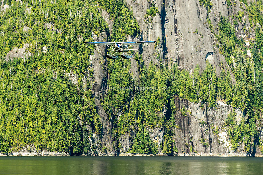 A floatplane comes in for landing in the waters of Misty fjords National monument.