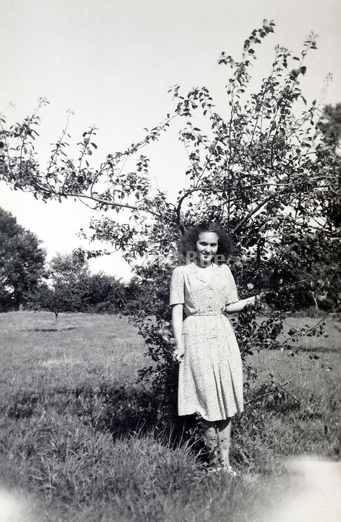young adult female posing by a tree rural France 1950s