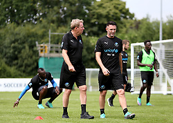 Harry Redknapp and Robbie Keane during the training session during the Soccer Aid for UNICEF training session at Motspur Park, London.