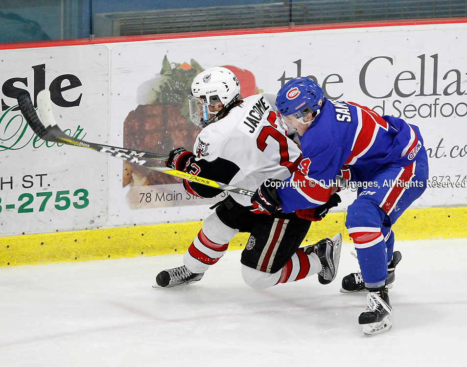 GEORGETOWN, ON  - MAR 18,  2017: Ontario Junior Hockey League, playoff game between the Georgetown Raiders and the Toronto Junior Canadiens. Jack Jacome #23 of the Georgetown Raiders tries to keep the puck from Braydon Sampson #4 of the Toronto Jr. Canadiens during the second period.<br /> (Photo by Tim Bates / OJHL Images)