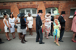 © London News Pictures. 20/06/2013. Ascot, UK.  Racegoers queue to enter the racecourse for Ladies Day on day three of Royal Ascot at Ascot racecourse in Berkshire, on June 20, 2013.  The 5 day showcase event,  which is one of the highlights of the racing calendar, has been held at the famous Berkshire course since 1711 and tradition is a hallmark of the meeting. Top hats and tails remain compulsory in parts of the course. Photo credit should read: Ben Cawthra/LNP