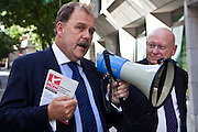 Elfyn Llwyd MP (right), westminster party leader of Plaid Cymru, the party of Wales speaking at the PCS demo with Hywel Williams MP for Caernarfon. The current Conservative government are proposing to close103 Magistrates Court and 54 County Courts in the UK as part of their current budget cut plans. PCS union members protest about job losses through court closures outside the Ministry of Justice (MOJ) building, central London. 15th September 2010.