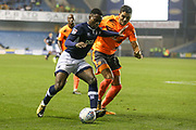 Fred Onyedinma of Millwall and Tiago Ilori of Reading during the EFL Sky Bet Championship match between Millwall and Reading at The Den, London, England on 26 September 2017. Photo by Toyin Oshodi.