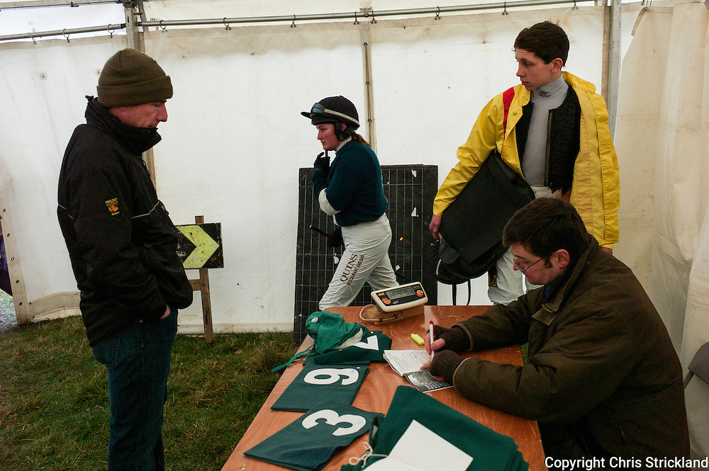 Steward Michael Hamilton weighs in the jockey's prior to the Hunt Members race at the Jedforest Point to Point.