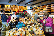 Tourists shopping at traditional cheese shop 't Kaaswinkeltje in Gouda, Holland, The Netherlands