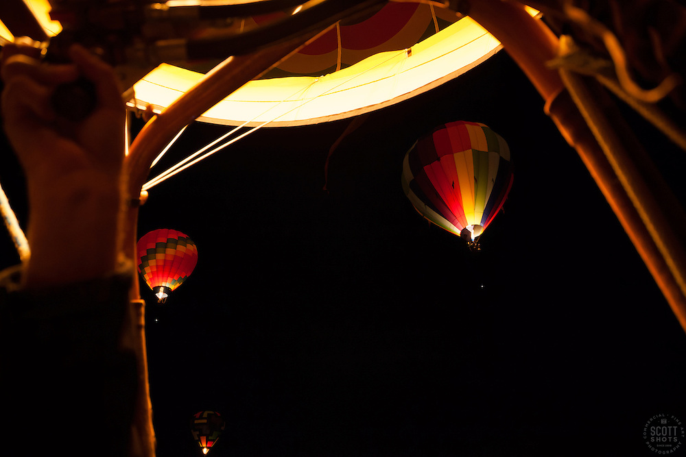 """Dawn Patrol 8"" - Photograph of the inside of a hot air balloon and of the Dawn Patrol at the 2012 Great Reno Balloon Race. Photographed from a hot air balloon."