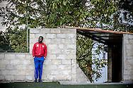 Potenza, Basilicata, Italia, 20/10/2014<br /> Ragazzi africani assistono all'allenamento della squadra di calcio Opt&igrave; Pob&agrave;. La squadra che porta il nome del fantomatico giocatore della Lazio inventato dal presidente della Figc Carlo Tavecchio partecipa a un campionato amatoriale di calcio a 11. L&rsquo;idea &egrave; venuta a Francesco Giuzio, ventisettenne potentino con una laurea in relazioni internazionali e un passato da analista video di partite di calcio.<br /> <br /> Potenza, Basilicata, Italy, 20/10/2014<br /> African guys attend a training session of the Opt&igrave; Pob&agrave; football team. The team has been formed in the wake of a racism scandal in which the new Italian football league president referred to black players whose only previous qualification was eating bananas. Opti Poba has joined an amateur championship in southern Italy. The team was born thanks to Francesco Giuzio, 27, who is also the coach.