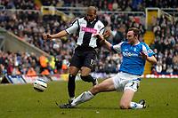 Photo: Richard Lane.<br />Birmingham City v West Bromwich Albion. The Barclays Premiership. 11/03/2006. <br />Birmingham's Martin Taylor (rt) tackles Diomansy Kamara.