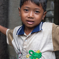 Cambodian boy posing at Angkor Wat.