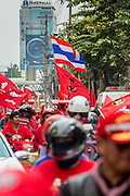 """10 DECEMBER 2012 - BANGKOK, THAILAND:   Red Shirt protestors mass on Petchaburi Rd in Bangkok near the offices of the ruling Pheu Thai party Monday to call for constitutional reform. The Thai government announced on Monday, which is Constitution Day in Thailand, that will speed up its campaign to write a new charter. December 10 marks passage of the first permanent constitution in 1932 and Thailand's transition from an absolute monarchy to a constitutional monarchy. Several thousand """"Red Shirts,"""" supporters of ousted and exiled Prime Minister Thaksin Shinawatra, motorcaded through the city, stopping at government offices and the offices of the Pheu Thai ruling party to present demands for a new charter.       PHOTO BY JACK KURTZ"""