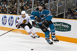 December 11, 2010; San Jose, CA, USA;  San Jose Sharks defenseman Douglas Murray (3) skates past Chicago Blackhawks right wing Troy Brouwer (22) during the first period at HP Pavilion. Mandatory Credit: Jason O. Watson / US PRESSWIRE