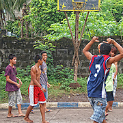 Young men playing a game of street basketball in the Hot Springs area of Laguna near the base of Mount Makiling
