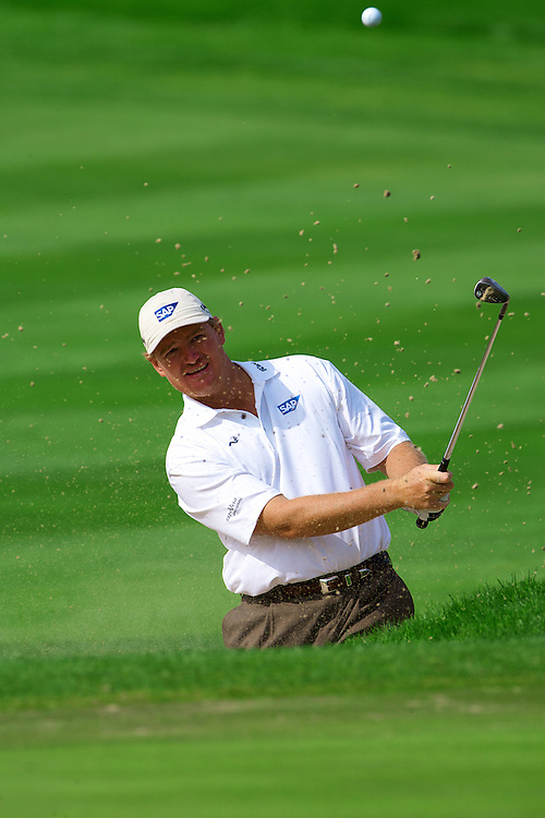 Ernie Els chipping out of the bunker and into the hole.