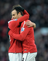 Dimitar Berbatov is congratulated by Wayne Rooney during the Barclays Premier League match between Manchester United and Blackburn Rovers at Old Trafford on November 27, 2010 in Manchester, England.