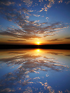A Very Colorful Mythical Sunset Over Still Water. This Is A Digital Composite Image