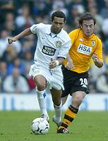 Photo. Andrew Unwin<br /> Leeds United v Blackburn Rovers, Barclaycard Premier league, Elland Road, Leeds 04/10/2003.<br /> Leeds' Jermaine Pennant (l) outpaces Blackburn's David Thompson (r).