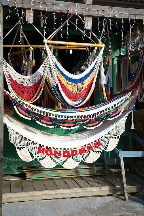 Roatan, Honduras:  Hammocks at Evelyn's Gift Shop on the main drag of West Bay, the commercial settlement at the far end of this barrier island off the north coast of Honduras.