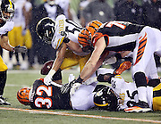Pittsburgh Steelers outside linebacker Jarvis Jones (95) and Pittsburgh Steelers inside linebacker Ryan Shazier (50) strip the ball from Cincinnati Bengals running back Jeremy Hill (32) on a late fourth quarter play in which Hill fumbles and the Pittsburgh Steelers recover the loose ball, leading to the Steelers dramatic comeback win, during the NFL AFC Wild Card playoff football game against the Pittsburgh Steelers on Saturday, Jan. 9, 2016 in Cincinnati. The Steelers won the game 18-16. (©Paul Anthony Spinelli)
