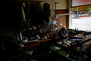 Guido Bartolacci in his tailor shop in New Kensington, Pa. Bartolacci moved to New Kensington from Italy with his wife and son in 1961 and joined his two brothers who had opened a tailoring shop years earlier.<br /> <br /> Tailoring is the family trade. Born in Colonnella, Italy, he was one of eight brothers and sisters and began apprenticing at the age of 11 and was trained in the art of fine tailoring.<br /> <br /> Although the front of his shop is full of fine suits, there is not much business in the still depressed town. The city's downtown has declined since the 1970's after the main industry, aluminum production by Alcoa, closed down operations the 1960s. There are very few businesses in operation today.