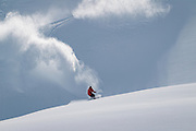 Squamish Local and pro snowboarder Mikey Rencz coming out of a couple of fast turns in the powder of the Coast Mountain Range of Southwestern British Columbia, near Whistler