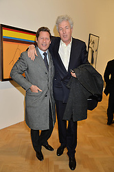 Left to right, ARKI BUSSON and the HON.HENRY WYNDHAM at the opening private view of 'A Strong Sweet Smell of Incense - A portrait of Robert Fraser, held at the Pace Gallery, Burlington Gardens, London on 5th February 2015.