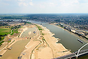 Nederland, Gelderland, Nijmegen, 26-06-2014; onder in beeld de nieuwe stadsbrug van Nijmegen over rivier de Waal, De Oversteek. Daarachter de spoorbrug met fietspad (De Snelbinder) en de laatste brug is de Waalbrug. Links van de rivier grondwerkzaamheden voor de Dijkteruglegging Lent (Ruimte voor de Rivier). Links Nijmegen-Noord, rechts binnenstad.<br /> First bridge the new city bridge of Nijmegen on the river Waal, De Oversteek (The Crossing). Next the railway bridge with cycle path De Snelbinder (The Luggage strap) and finally the Waal bridge. To the left of the river groundwork for the Dike relocation of Lent (project Ruimte voor de Rivier: Room for the River). Nijmegen city on the horizon.<br /> luchtfoto (toeslag op standaard tarieven);<br /> aerial photo (additional fee required);<br /> copyright foto/photo Siebe Swart.
