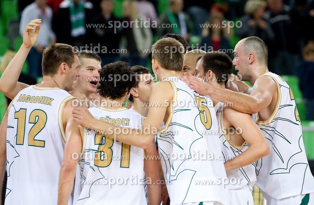 Players of Olimpija celebrate after winning the basketball match between KK Union Olimpija and Igokea in First round of NLB league in Arena Stozice on October 9, 2010 in SRC Stozice, Ljubljana, Slovenia. Union Olimpija defeated Igokea 61-54. (Photo by Vid Ponikvar / Sportida)