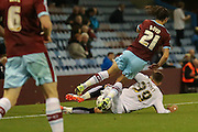 Milton Keynes Dons midfielder, on loan from West Ham United, Diego Poyet fouls Burnley midfielder George Boyd  during the Sky Bet Championship match between Burnley and Milton Keynes Dons at Turf Moor, Burnley, England on 15 September 2015. Photo by Simon Davies.