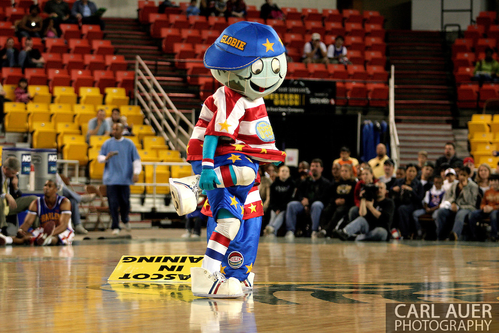 "04 May 2006: The Globetrotters mascot ""Globie"" dances during a time out in the first period of the Harlem Globetrotters vs the New York Nationals at the Sulivan Arena in Anchorage Alaska during their 80th Anniversary World Tour.  This is the first time in 10 years that the Trotters have visited Alaska."