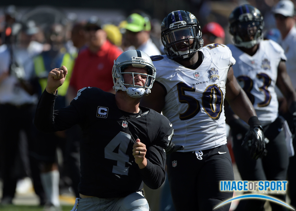Sep 20, 2015; Oakland, CA, USA; Oakland Raiders quarterback Derek Carr (4) celebrates after an 18-yard run in the third quarter as Baltimore Ravens linebacker Albert McClellan (50) watches at O.co Coliseum.  The Raiders defeated the Ravens 37-33.