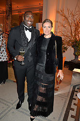 SOL CAMPBELL and his wife FIONA BARRATT at the inaugural dinner for The Queen Elizabeth Scholarship Trust hosted by Viscount Linley at the V&A museum, London on 25th February 2016.
