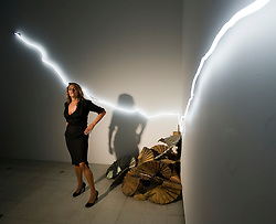 """© licensed to London News Pictures. London, UK. 16/05/2011. Tracey Emin poses next to her artwork """"Sleeping With You""""  at a photo call for the preview of Tracey Emin's new exhibition """"Love is What You Want"""" at Hayward Gallery, Southbank, London today (16/05/2011).  Photo credit should read Ben Cawthra..."""