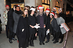 NICHOLAS KIRKWOOD and Carol singers at a party to celebrate the launch of a limited edition shoe The Chambord in celebration of Nicholas Kirkwood's partnership with Chambord black raspberry liqueur, held at the Nicholas Kirkwood Boutique, 5 Mount Street, London on 12th December 2012.