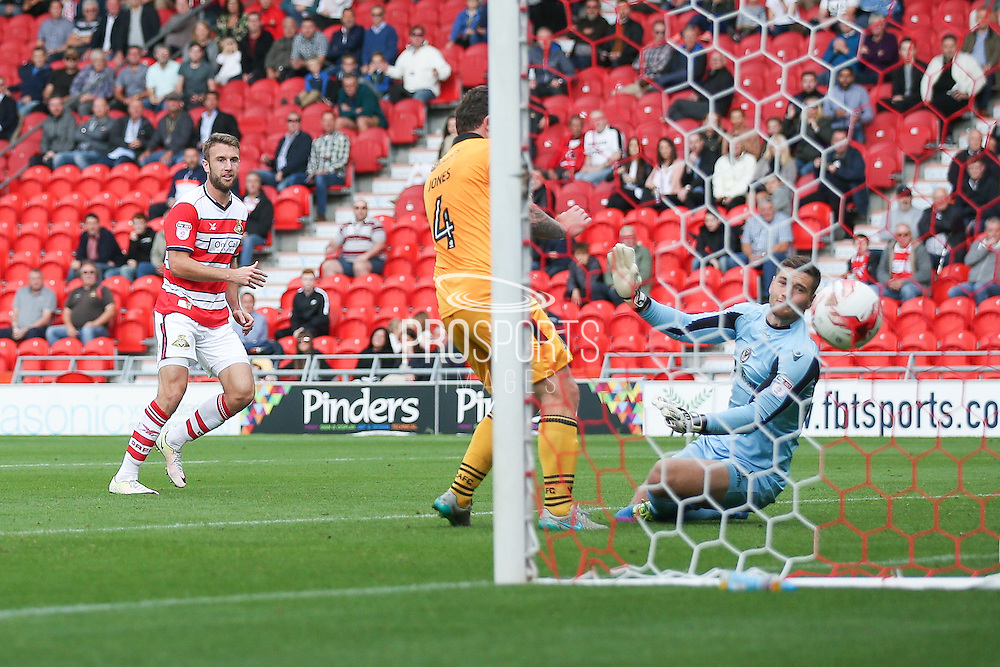 Doncaster Rovers forward Andy Williams (11) scores a goal and celebrates to make the score 2-0 during the EFL Sky Bet League 2 match between Doncaster Rovers and Newport County at the Keepmoat Stadium, Doncaster, England on 17 September 2016. Photo by Simon Davies.