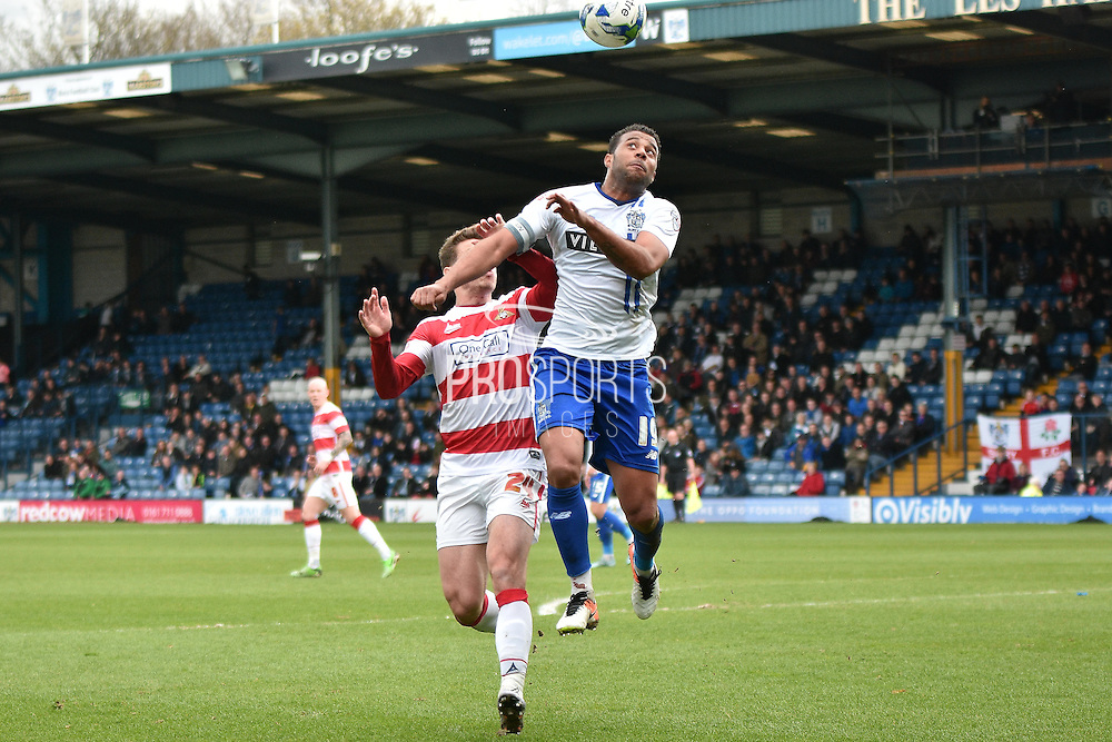 Bury Midfielder, Tom Soares and Doncaster Rovers On loan Midfielder, Tommy Rowe battle for a header during the Sky Bet League 1 match between Bury and Doncaster Rovers at the JD Stadium, Bury, England on 9 April 2016. Photo by Mark Pollitt.