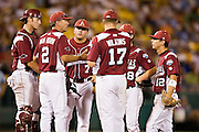 OMAHA, NE - JUNE 17:   Head Coach Dave Van Horn of the Arkansas Razorbacks talks with his infield players during extra innings against the Virginia Cavaliers at the College World Series on June 17, 2009 at Rosenblatt Stadium in Omaha, Nebraska.  Arkansas defeated Virginia 4 - 3 in 12 innings.  (Photo by Wesley Hitt/Getty Images) *** Local Caption *** Dave Van Horn