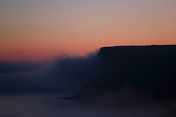 © Licensed to London News Pictures.02/11/15<br /> Saltburn, UK. <br /> <br /> Heavy fog shrouds cliffs at Huntcliff on the Cleveland coast.<br /> <br /> Photo credit : Ian Forsyth/LNP