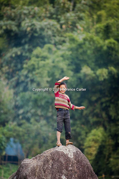 A hilltribe boy plays in the hills above Sapa, Vietnam.