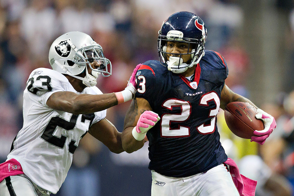 HOUSTON, TX - OCTOBER 9:   Arian Foster #23 of the Houston Texans is pushed out of bounds while running the ball by DeMarcus Van Dyke #23 of the Oakland Raiders at Reliant Stadium on October 9, 2011 in Houston, Texas.  The Raiders defeated the Texans 25 to 20.  (Photo by Wesley Hitt/Getty Images) *** Local Caption *** Arian Foster; DeMarcus Van Dyke